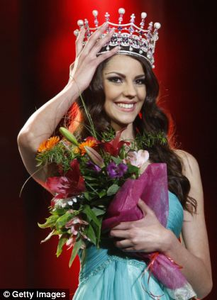 Karina Zhyronkina, 21-year-old Ukrainian student, holds her crown after being elected Miss Ukraine 2012
